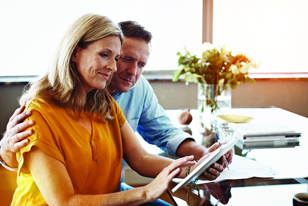 Couple looking at their tax documents together